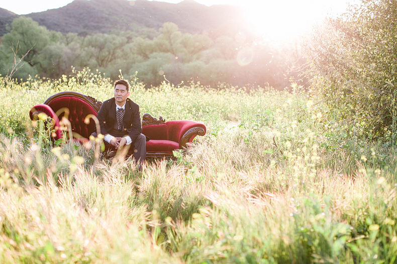Groom on chaise in middle of field