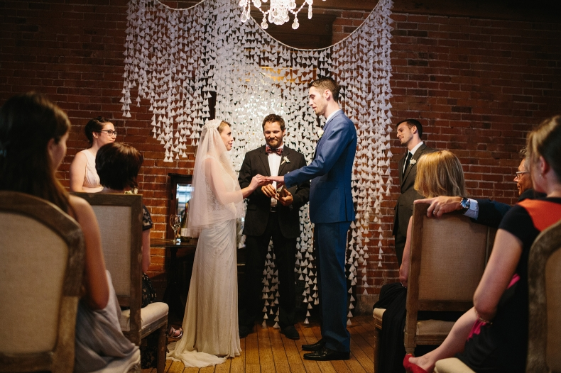 This is a photo of Alannah and Evan exchanging rings.