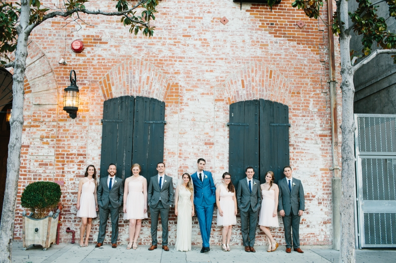 This is a full wedding party photo in the front of the venue.