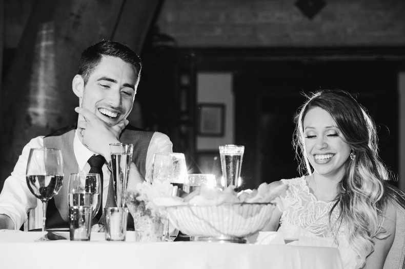 Alannah and Evan are laughing at the best man at their Carondelet House wedding.