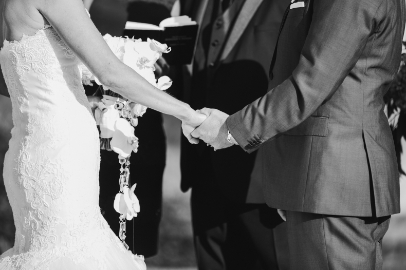 We love it when couples hold hands during their ceremony.