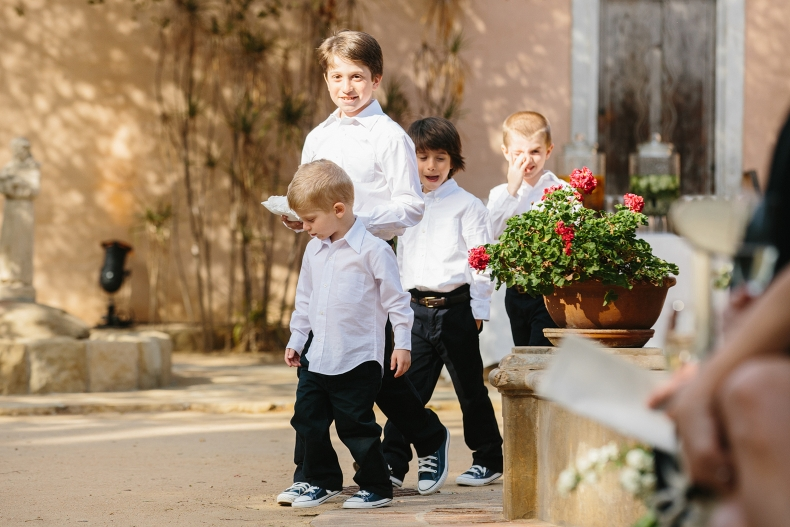 The ring bearers walking down the aisle.