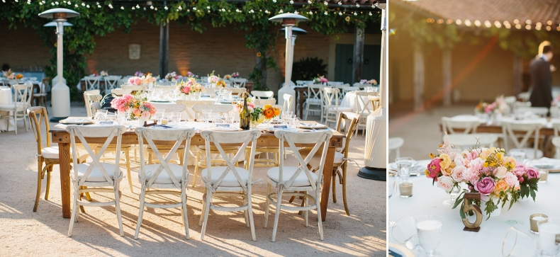 A reception with a mix of wood tables and cream linen table cloths.
