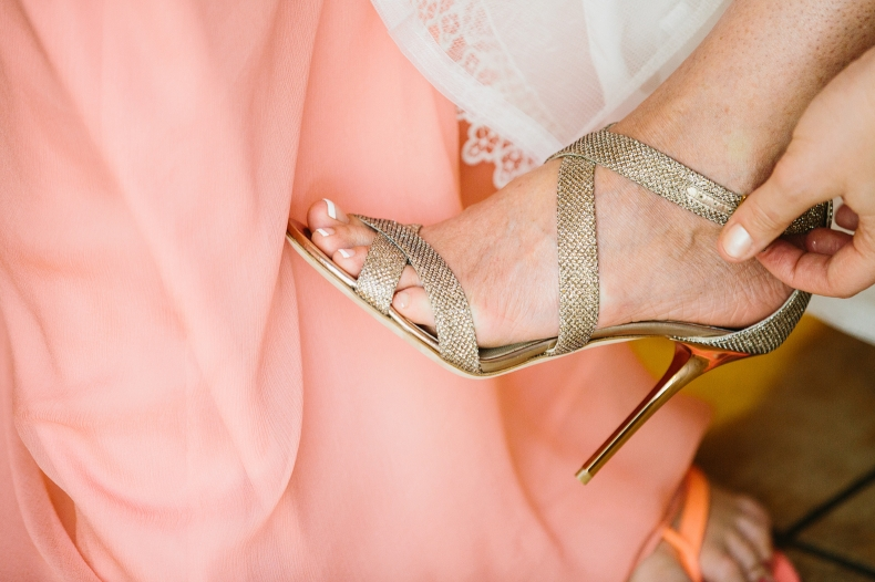 Sidney wore beautiful gold strappy heels.