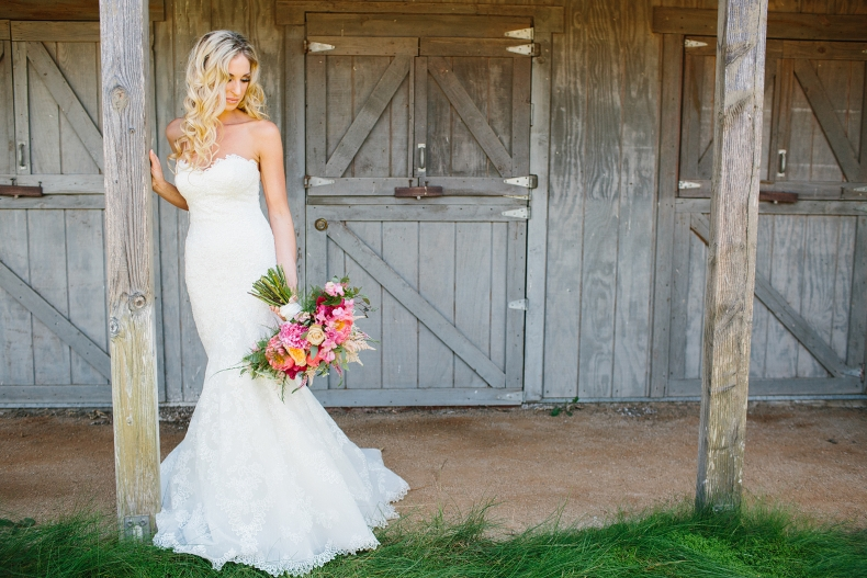Here is a beautiful photo of the bride in front of the barn.