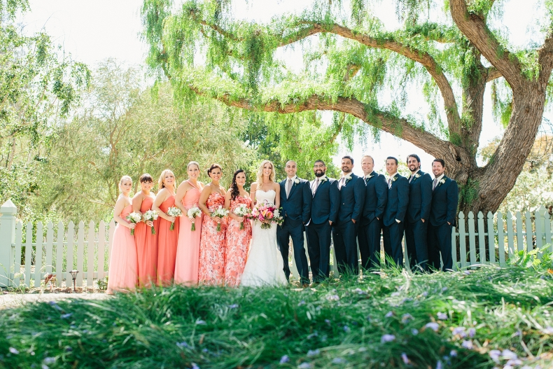 Here is photo of the full wedding party in front of the green pickett fence.