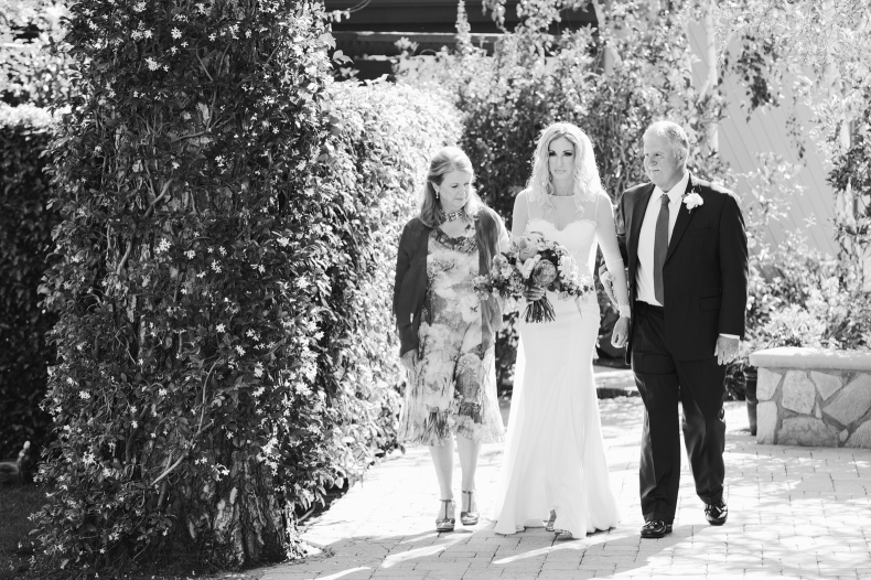 Here is a photo of the bride and her parents right before she walked down the aisle.