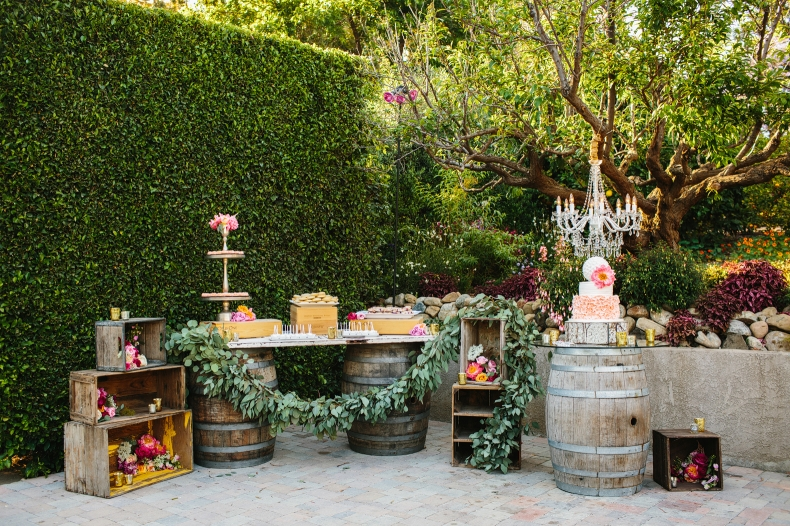 The couple had a dessert bar on wine barrels.