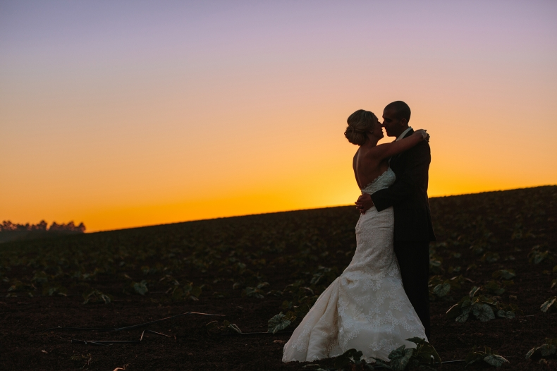 This is a beautiful bride and groom sunset photo.