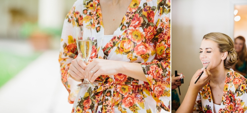 The bride wore a bright colorful floral robe during getting ready.