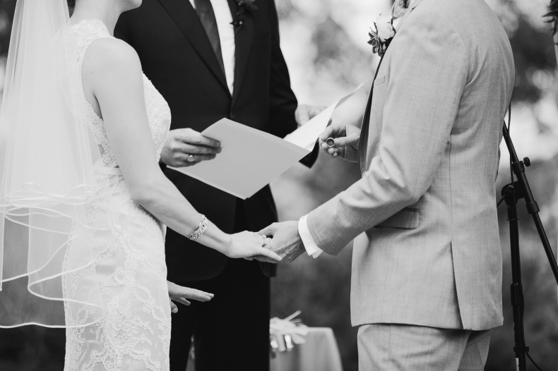 This is a photo of the groom putting on the bride