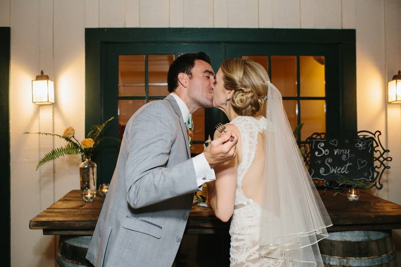 Here is a cute photo of the bride and groom kissing after cake cutting.