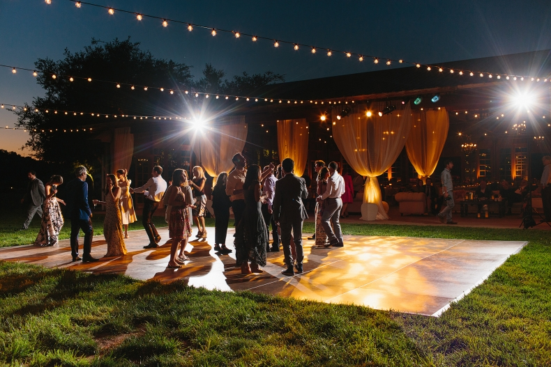 A photo of guests dancing during the reception.