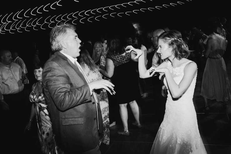 A photo of Caitlin dancing with a guest.
