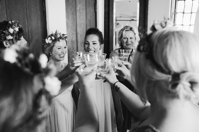 Emily and the bridesmaids toasting.