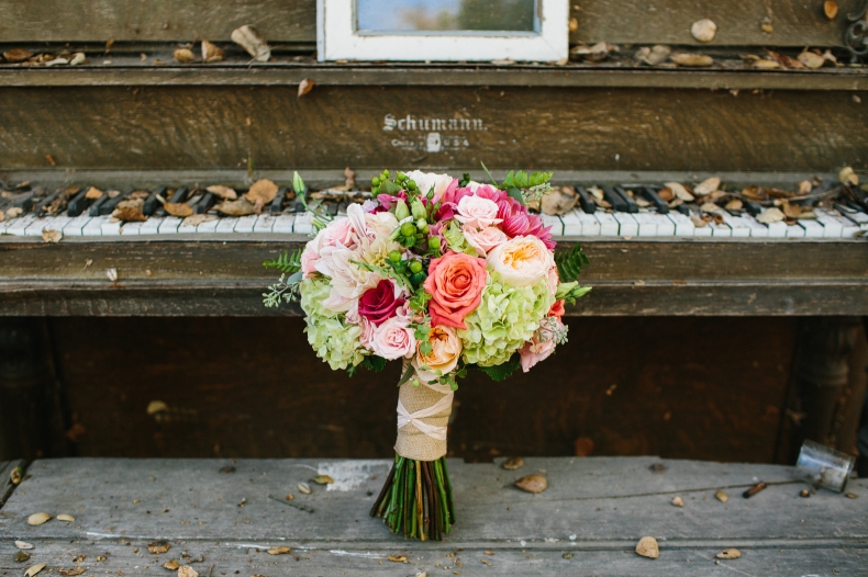 Bridal bouquet on rustic old piano.