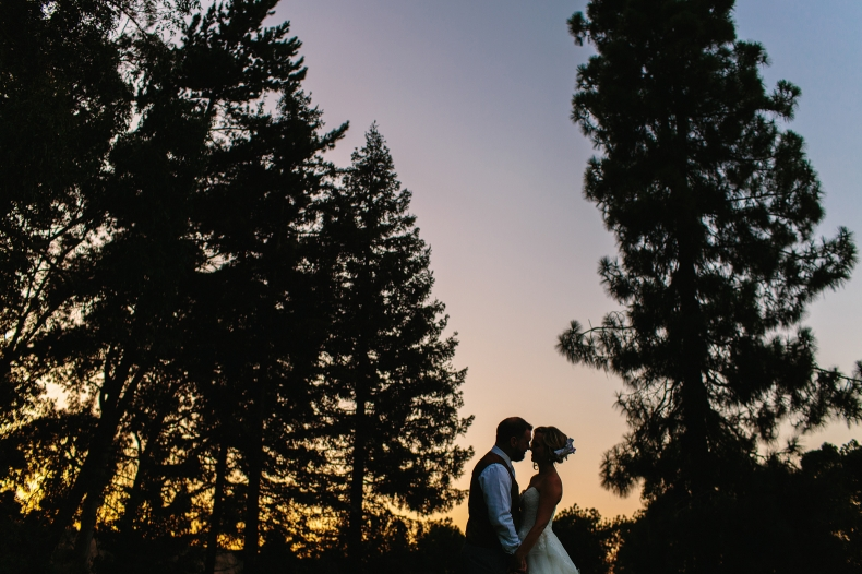 A beautiful sunset photo of the bride and groom.