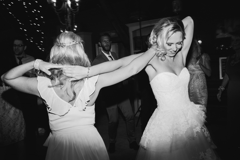 Brooke and one of her bridesmaids dancing.