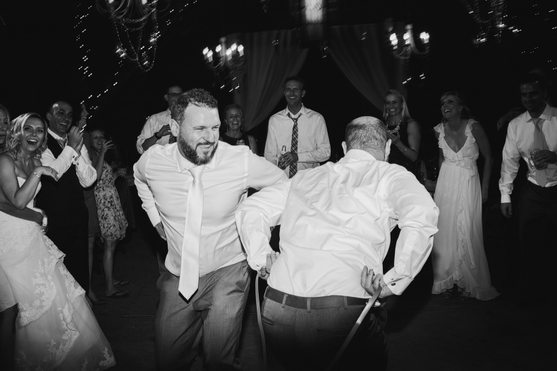 The groom dancing with a groomsmen.