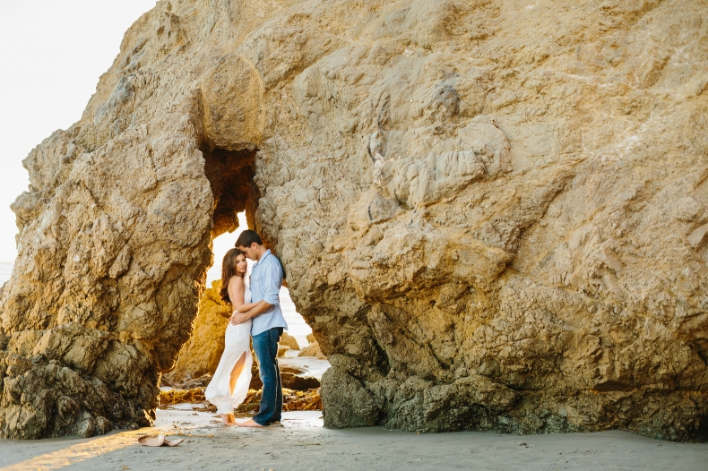 The couple under a large rock.