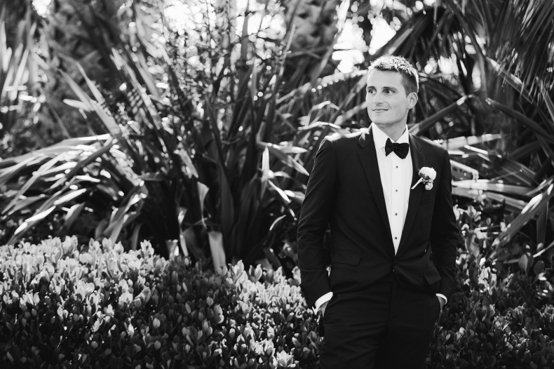 A black and white shot of the groom.
