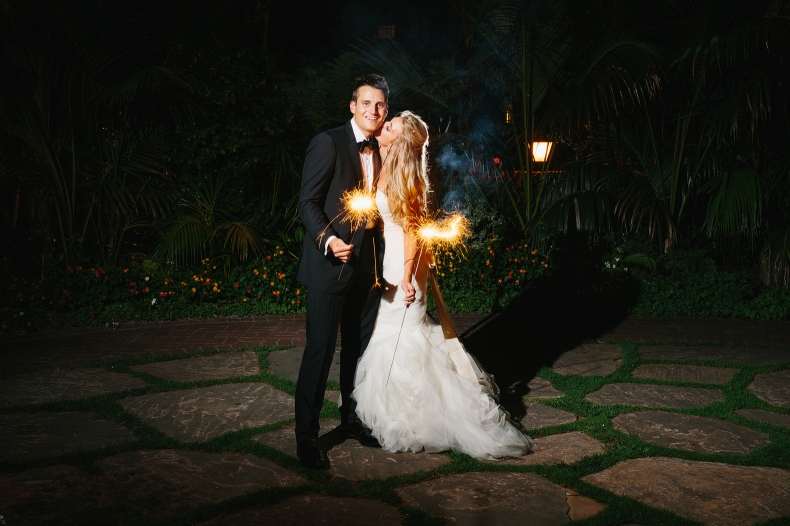 Jaclyn and Nick holding sparklers.