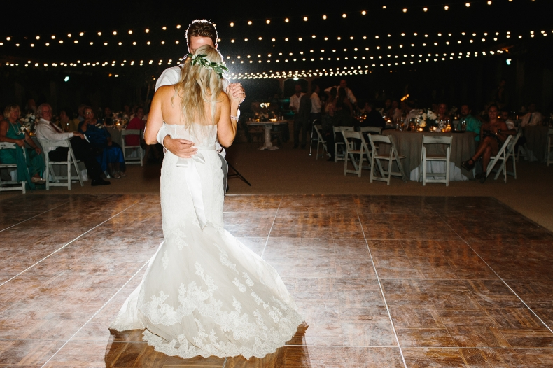 A photo of the back of the bride