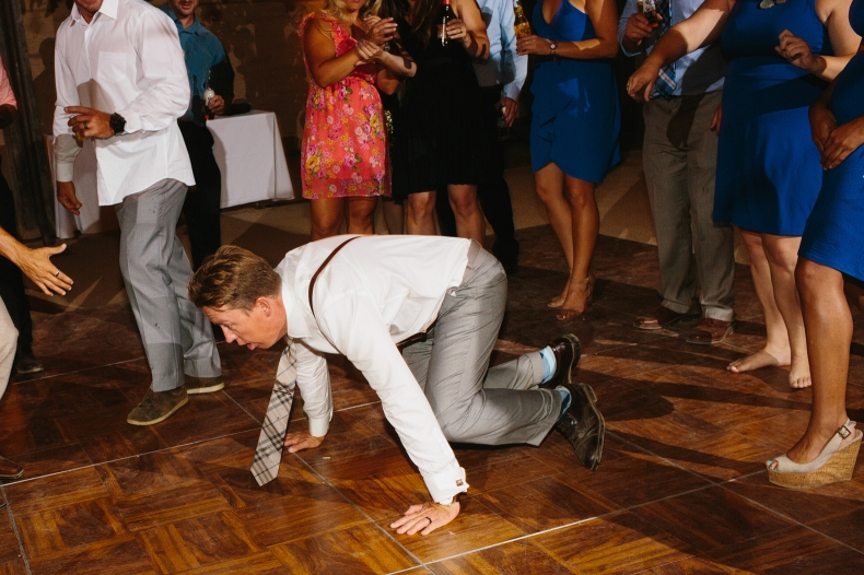 The groom break dancing.