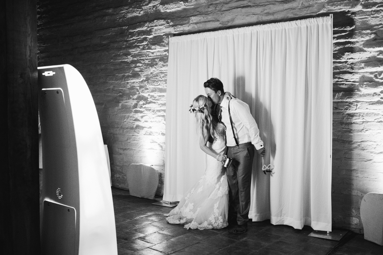 The bride and groom using the photobooth.