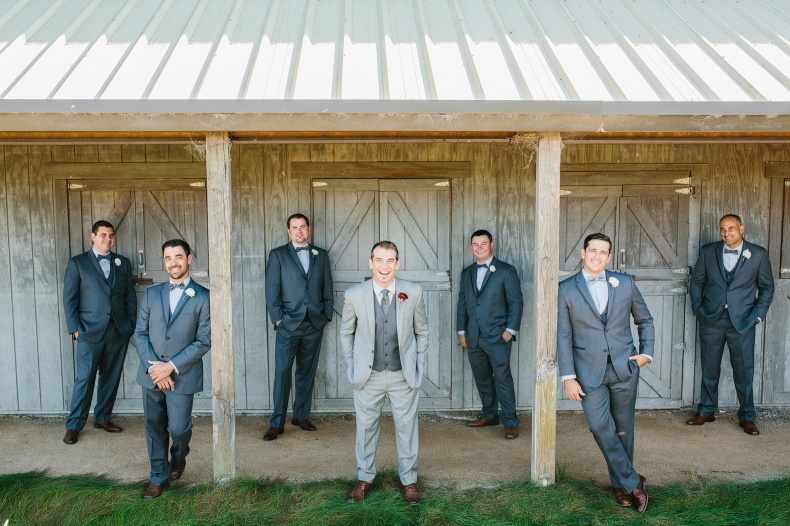 The groom and groomsmen by the barn.