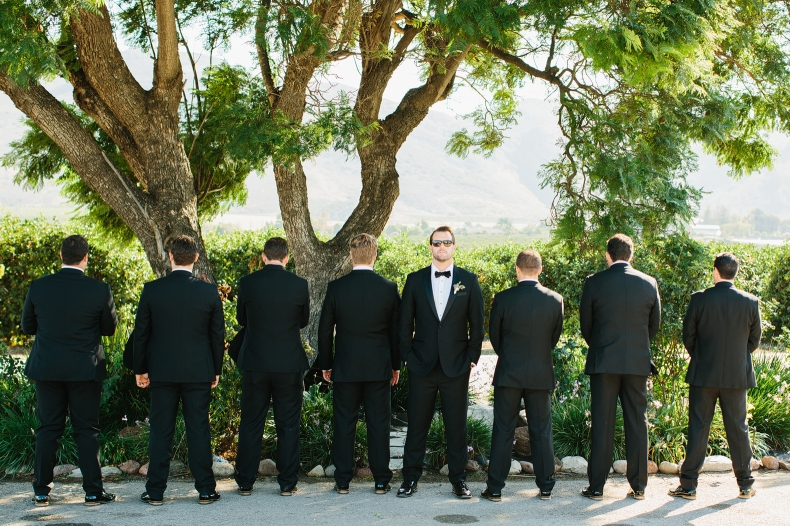 The groom in sunglasseses with the groomsmen.