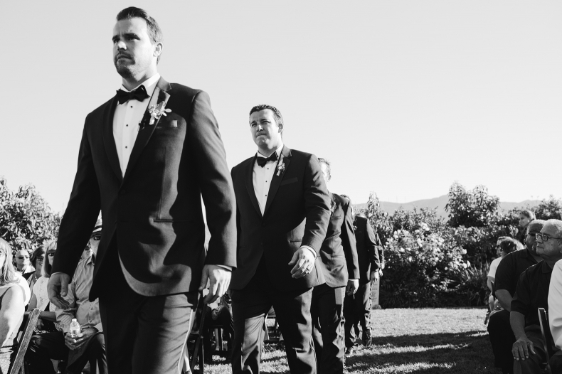 The groom and groomsmen walking into the wedding ceremony.