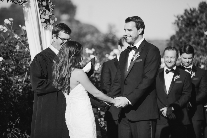 Andy smiling at Larissa during the ceremony.