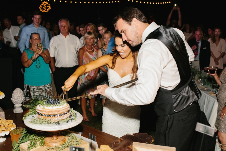 Larissa and Andy cutting the cake.