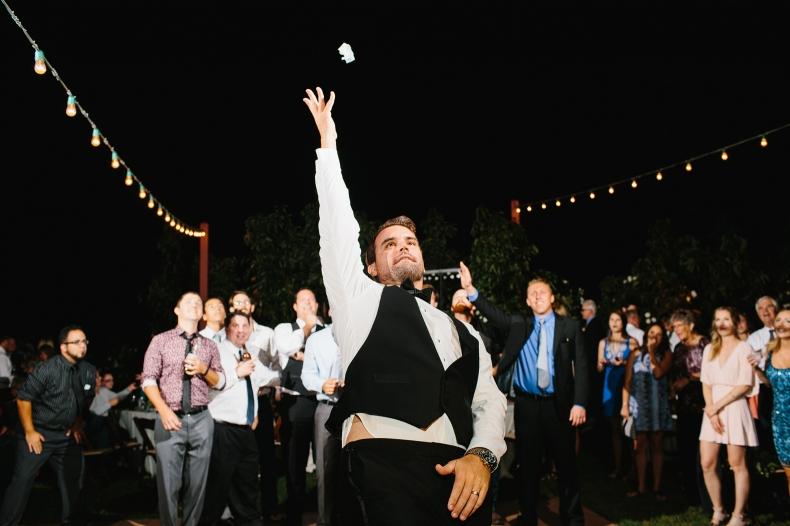 The garter toss during the reception.