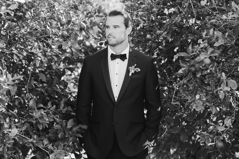 A black and white portrait of the groom.