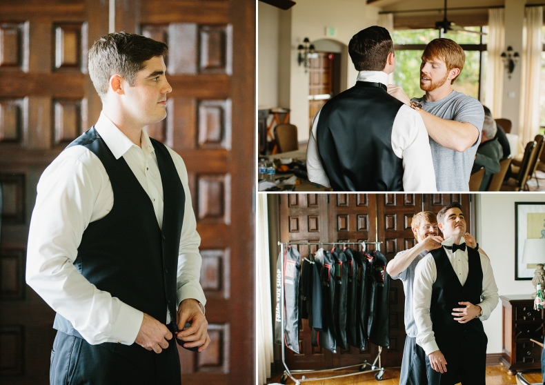 A groomsmen helping Steve put on his bowtie.