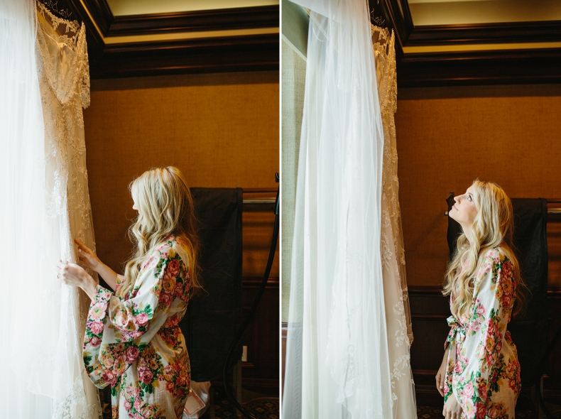 A beautiful photo of the bride looking at her wedding dress.