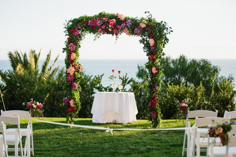 The beautiful floral ceremony arch.