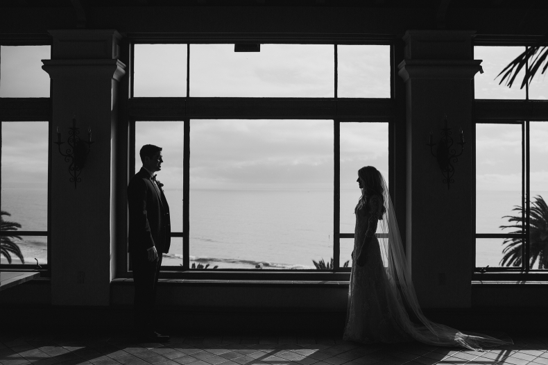 A black and white silhouette in front of the window.