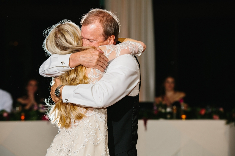 A sweet hug between the bride and her dad.