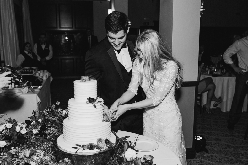 Britt and Steve cutting their cake.