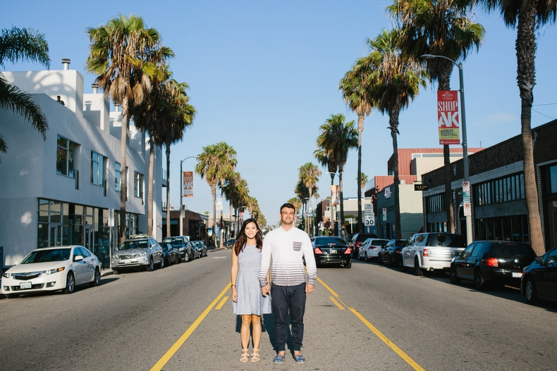 The couple standing in the middle of the street.