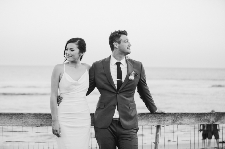 Bride and groom portraits on the beach.