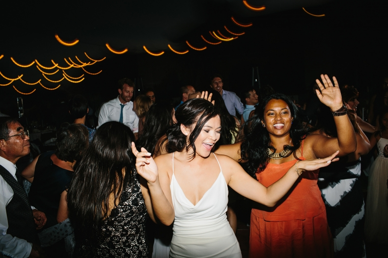 The bride dancing with guests.