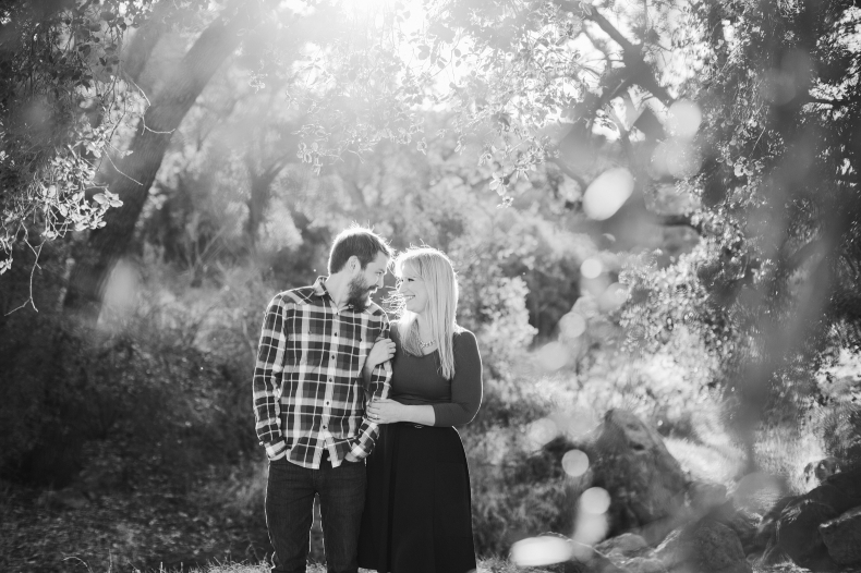 A beautiful photo of the couple through leaves.