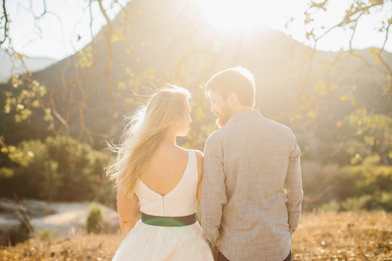 A beautiful bright photo of the couple looking out.