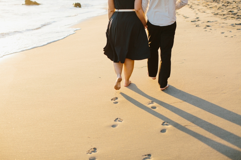 Lindsay and Josh walking on the beach.