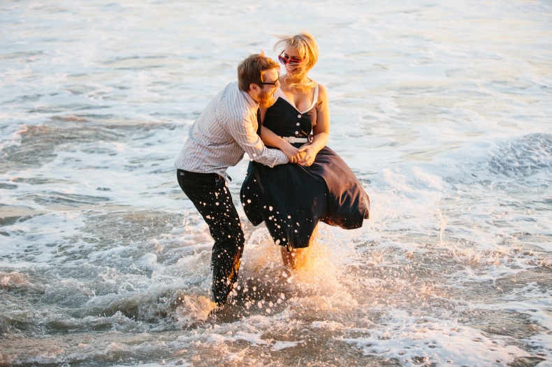The couple splashing in the beach.
