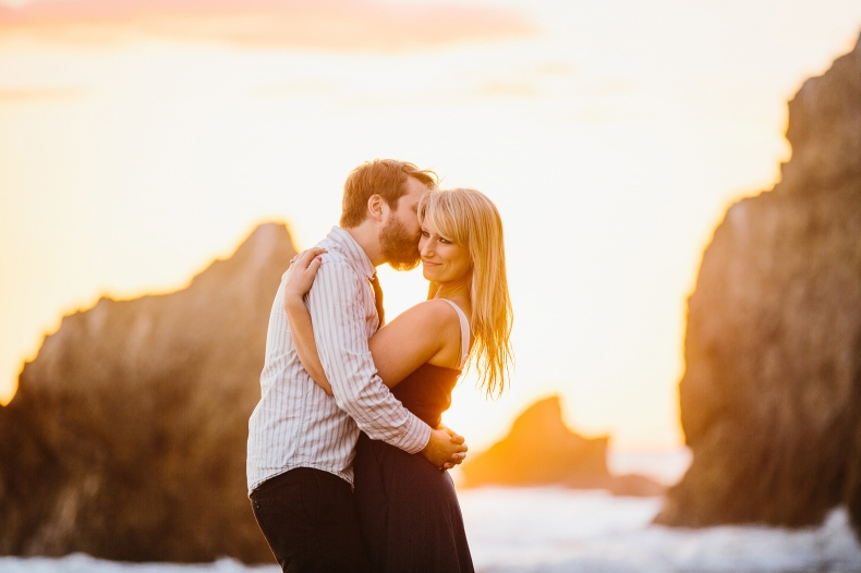 The couple on the beach at sunset.